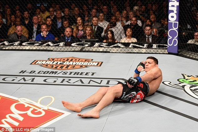 Nate Diaz laying down in octagon
