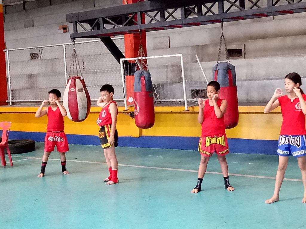 Kids practicing kickboxing